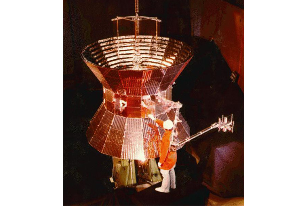 Image of Helios spacecraft with person in front of it