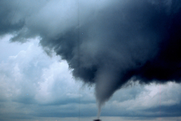 Large tornado approaching a house