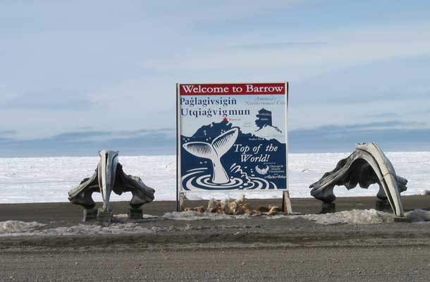 Sign with Whale Tale image that says welcome to Barrow