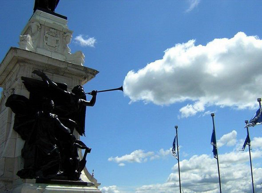 Statue's trumpet blowing clouds