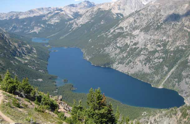 mystic lake surrounded by mountains