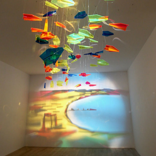Colorful scene on wall using shadows