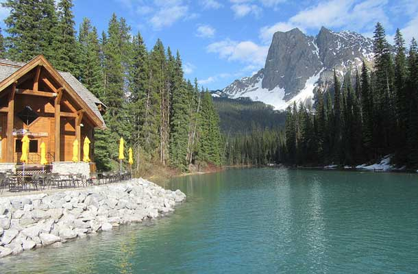 emerald lake with cabin to the left