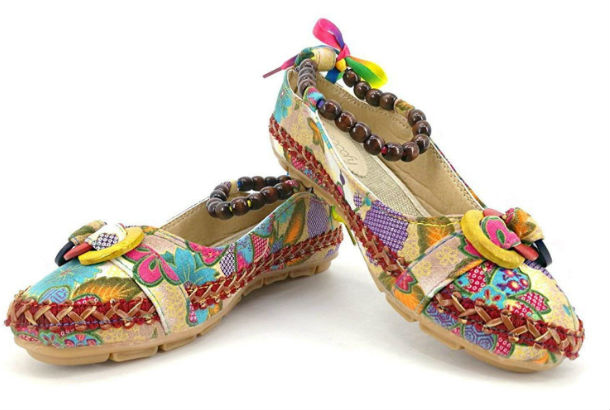 brown slippers with colorful images, laces, and beaded ankle bracelet