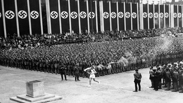 Hitler's regime reinstate the ancient Olympic torch during the 1936 Olympics