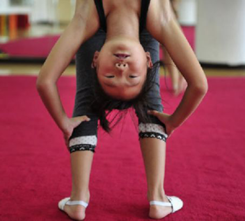 Young gymnast doing a backbend