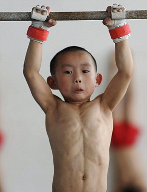 Young Chinese gymnast training