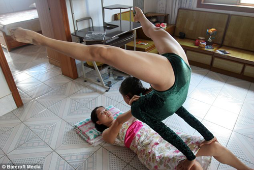Young Chinese Gymnast stretching