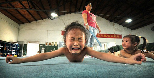 Young Chinese gymnast crying in pain