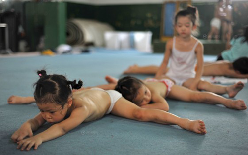 Young Chinese gymnasts stretching