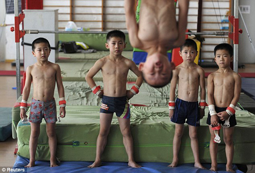 Young Chinese gymnasts in training