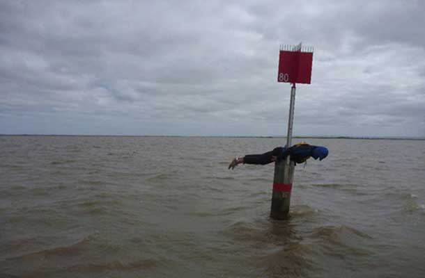 Planking on post in the ocean