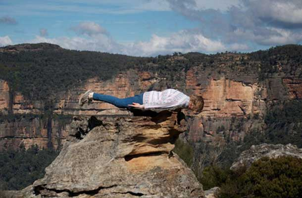 planking on a rock at the grand canyon