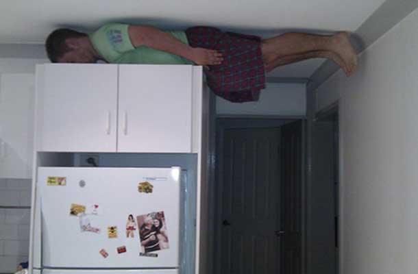 planking on a cabinet 8 feet in the air