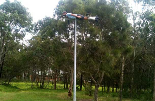 Planking on top of a pole