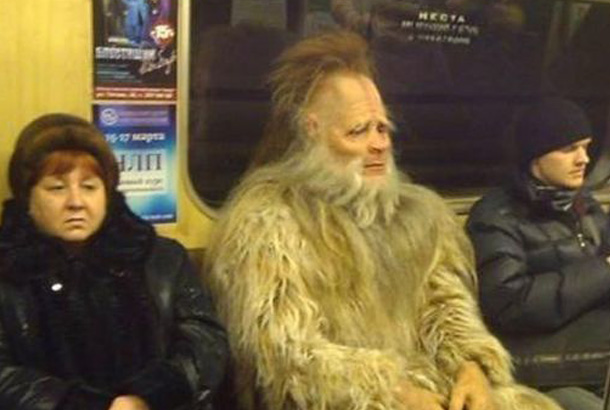 person who appears to be a yeti sitting on subway
