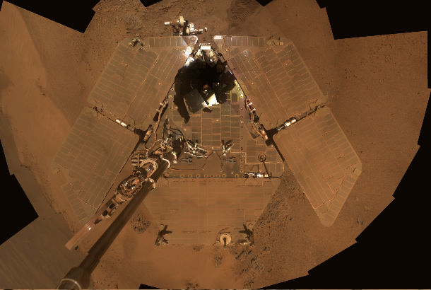 image of solar panels covered in red dust