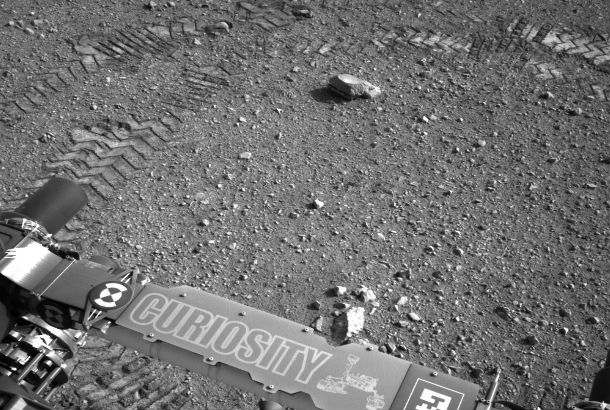 close up of back of rover with tire tracks in background