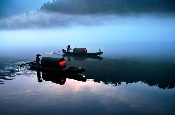 River Ferry Operating in the Early Morning in Xiao Donjiang, China