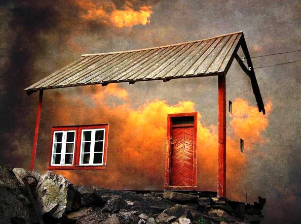 A Whimsical House Set in the Burning Clouds of a Fiery Sunset