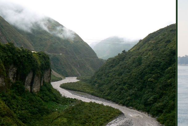 The Amazon river winding between two mountains