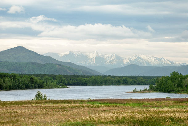 Yenisei River from bank with mountain in background