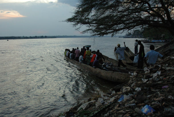 Congo River from bank with boat full of people