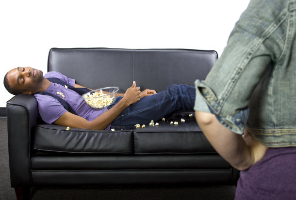 man on couch woman angry