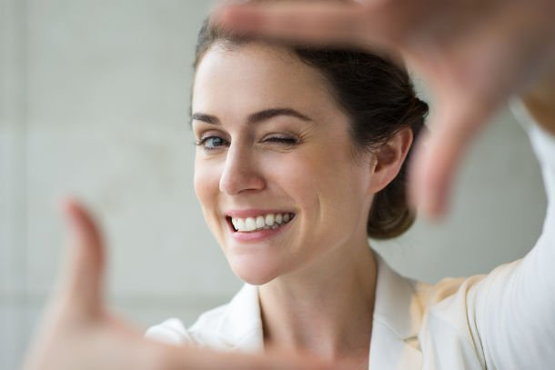 smiling woman hands in frame