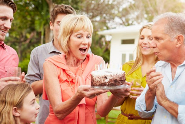 woman surprised by cake
