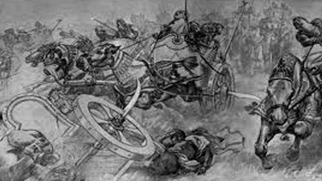 http://en.wikipedia.org/wiki/File:The_charge_of_the_Persian_scythed_chariots_at_the_battle_of_Gaugamela_by_Andre_Castaigne_(1898-1899).jpg