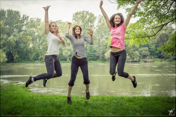 3 girls jumping and smiling
