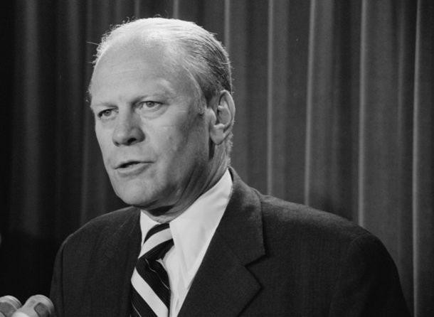 Gerald_Ford_speaking_into_microphones,_9_Aug_1974