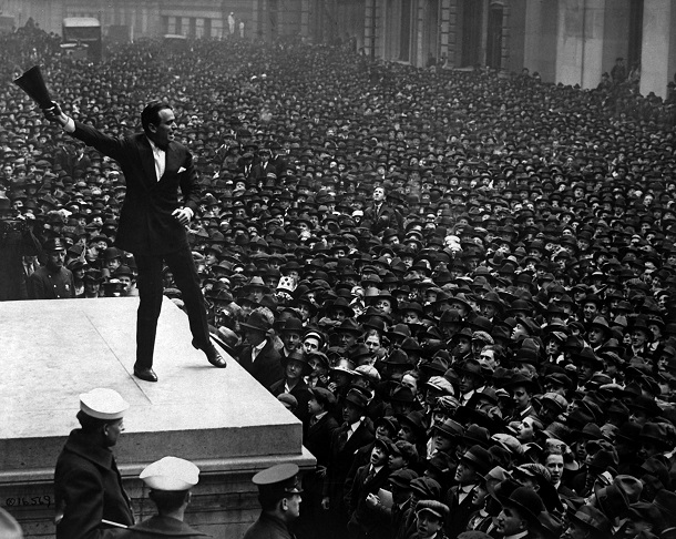 Douglas Fairbanks, movie star, speaking in front of the Sub-Treasury building, New York City, to aid the third Liberty Loan. April 1918.