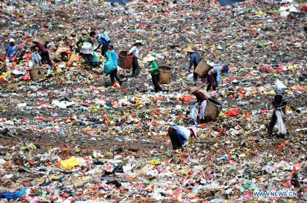 Scavengers look for recyclable things at a trash dump in Nanning in southern China