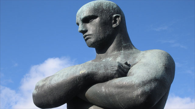 Statue with crossed arms
