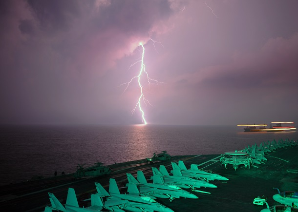 Lighting flashes as the aircraft carrier USS Abraham Lincoln (CVN 72) transits the Straight of Malacca.