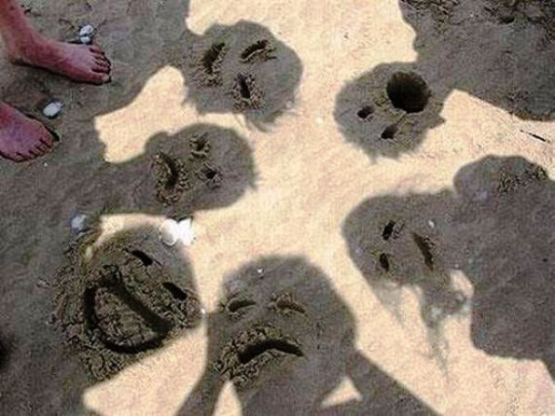 faces in sand