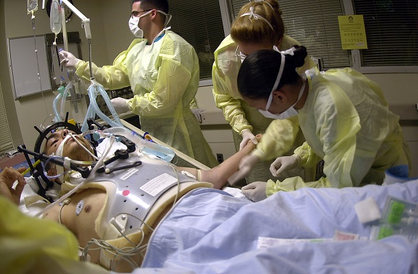 Navy Hospital Corpsmen and Medical Officers assess the treatment and prognosis of a patient with a gunshot wound to the head in the Intensive Care Unit (ICU) at the Los Angeles County, University of Southern California (USC) Medical Center. The students are part of an outreach cooperative training program between Navy Medicine and the medical center. The Naval Trauma Training CenterÕs (NTTC) mission is to provide trauma experience and knowledge to Naval medical personnel before they deploy. The students from Naval Hospitals, clinics and commands at Naval Installations around the world, work in the emergency room, operating room and intensive care unit, to learn about the wide range of situations they may encounter when sent into the field. U.S. Navy photo by PhotographerÕs Mate 2nd Class Johansen Laurel (RELEASED)