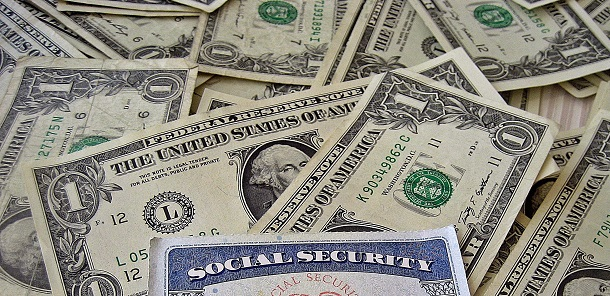 social security card with dollars