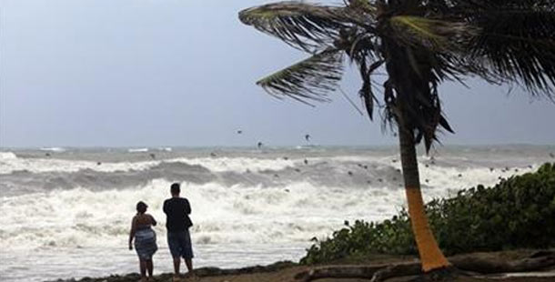 Tropical Storm Erika's approach as by standers look on at a Dominican Beach