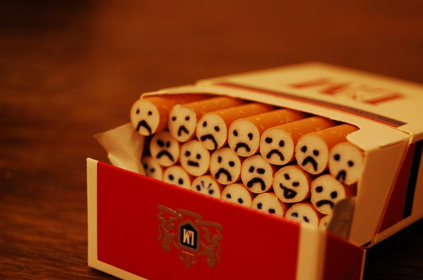 cigarette pack with faces