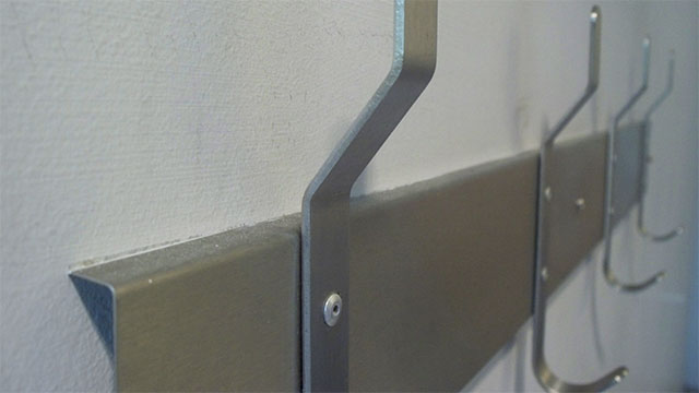Rather than towel rods, use coat hooks
