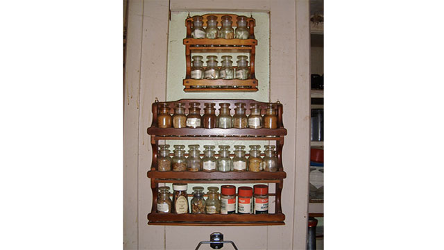 Spice racks are a really good way to hang lotions and other products