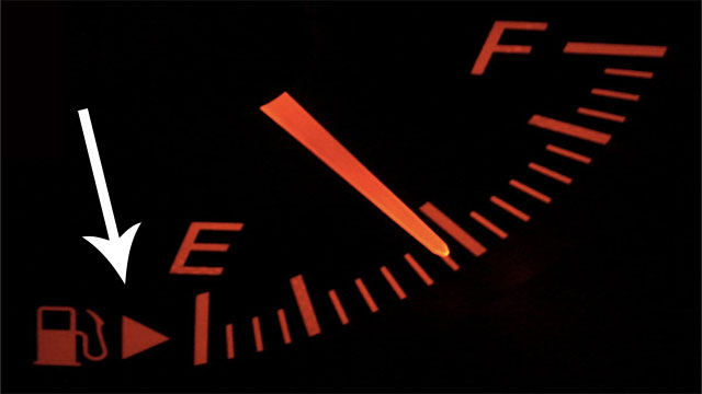 In case you're driving an unfamiliar car, the arrow next to the gas pump (on the speedometer) shows you which side the gas tank is on