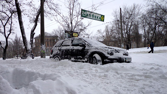 You can use the floormats in your car for traction if you get stuck in the snow or mud