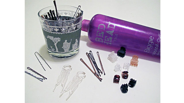 Put magnetic strips behind your cabinets and you can hang your bobby pins and tweezers from them
