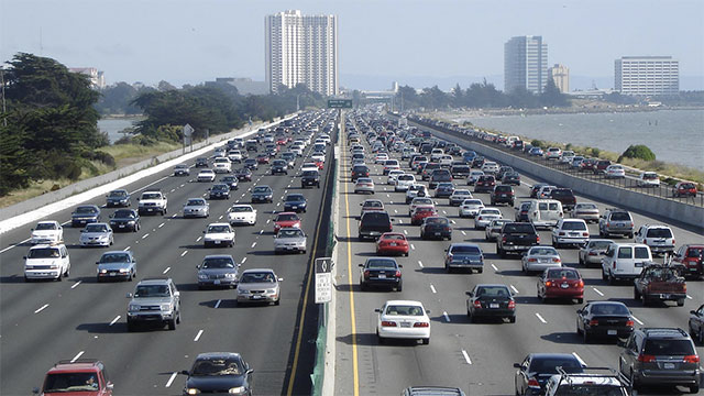 Don't keep changing lanes. Studies have shown that even in the best scenario it will only give you a minimal advantage with a significant downside (your chances of getting in an accident skyrocket)