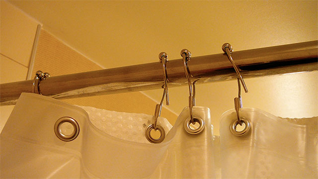 Extra shower curtain rods are also a good way to add space within the shower area