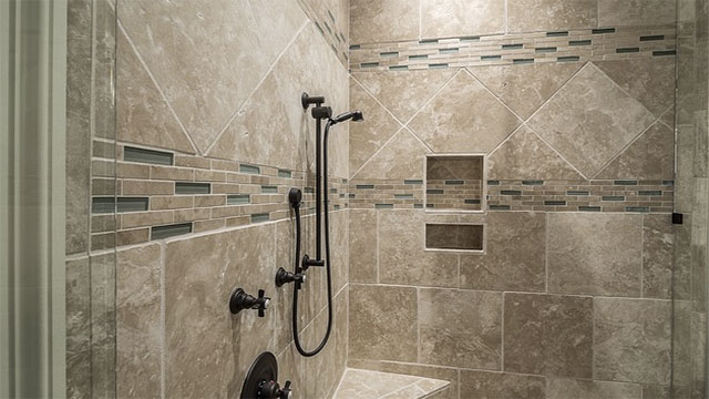 Why do shower curtains billow inwards?